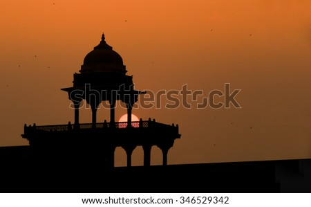 Silhouette of Fatehpur Sikri - Courtyard Palace with Tombs - stock photo