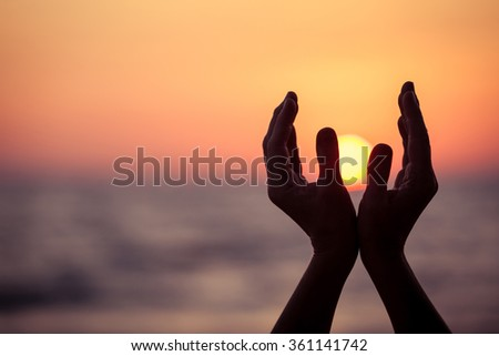 silhouette of female hands during sunset. Concept of life. - stock photo