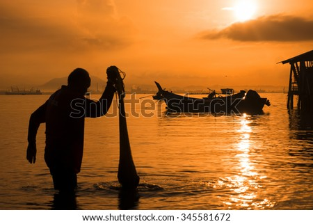 Silhouette of Fisherman and Nets at Sunrise