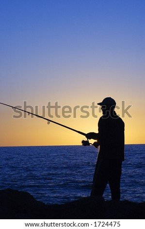 Silhouette of Fisherman at sunset at Cottesloe beach , Perth - stock photo