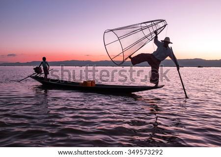 Silhouette of fisherman at sunset Inle Lake Burma Myanmar - stock photo