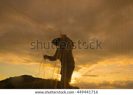Silhouette of fishermen at the river.