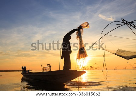 silhouette of fishermen, Talay Noi, Phatthalung Province, Thailand