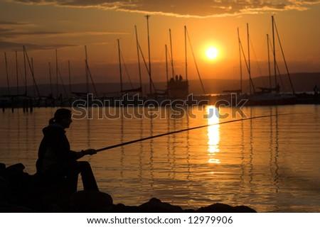 silhouette of fishing woman - stock photo