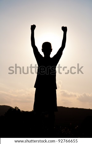 Silhouette of free boy happy and victory