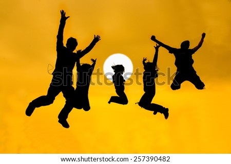 silhouette of friends jumping - stock photo