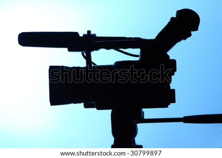 silhouette of full HD camcorder - stock photo