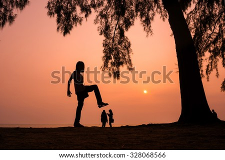 Silhouette of Giant Girl Kids Trampling People near the beach - stock photo