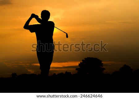Silhouette of golfer - stock photo