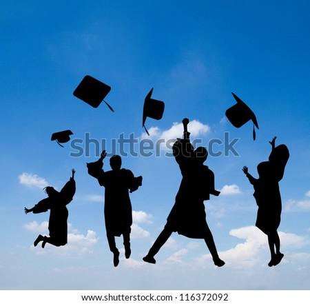 Silhouette of graduates celebrating - stock photo