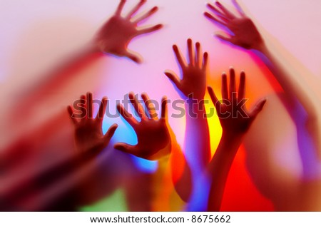 silhouette of hands on colorful back. Image may contain slight multicolor aberration as a part of design - stock photo