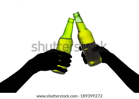 Silhouette of hands toasting with bottles of beer - stock photo