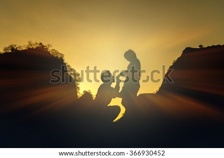 Silhouette of happy lover holding each other