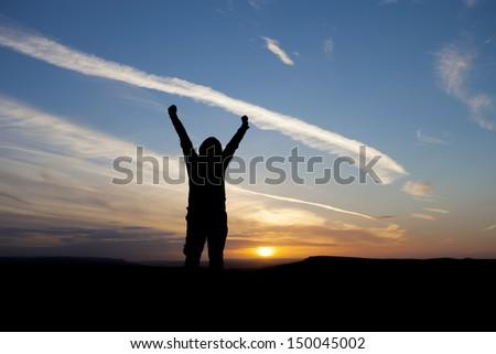 silhouette of happy man, winning - stock photo