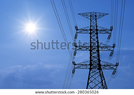 silhouette of high voltage electric tower with beautiful sunlight  background