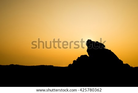 silhouette of hill on sunset