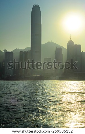 Silhouette of Hong Kong Downtown at sunset - stock photo