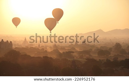 Silhouette of Hot Air Balloons over the temples of Bagan in misty morning, Myanmar - stock photo