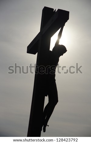 Silhouette of Jesus Christ,  Hill of Crosses, Lithuania - stock photo