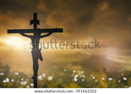 Silhouette of Jesus Christ with Cross over sunset concept for religion worship Christmas Easter Redeemer Amazing grace prayer and praise dramatic sky vintage redeemer life revelation love world - stock photo