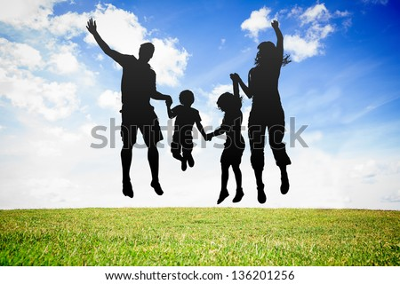 Silhouette of jumping family against sky background - stock photo