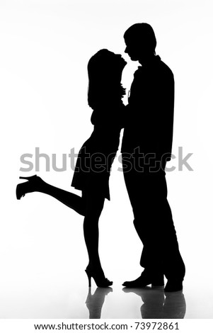 silhouette of kissing happy couple ready for your logo isolated on white background