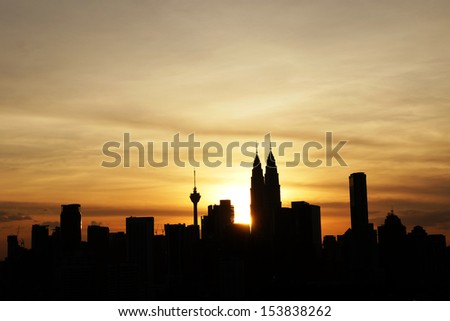 Silhouette of Kuala Lumpur city scape during sunset at Malaysia, Asia