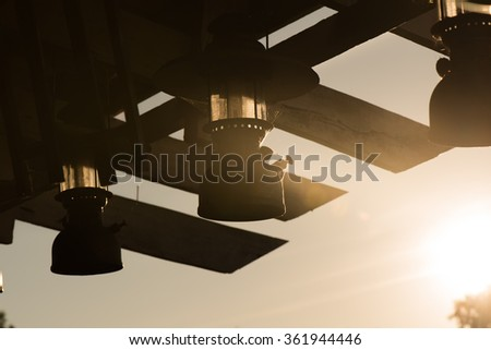 Silhouette of lamp decorated on sunset