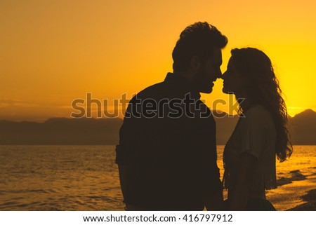 Silhouette of Loving Couple at Sunset - stock photo