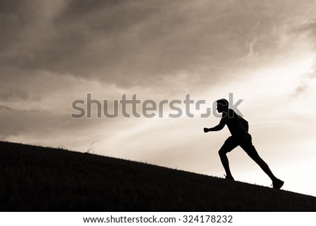 Silhouette of male running