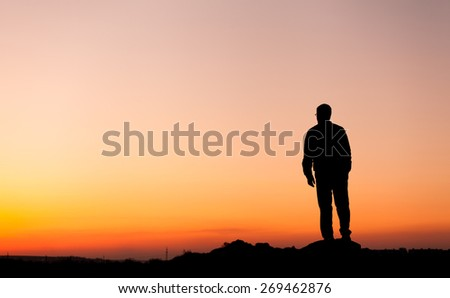 Silhouette of man and beautiful sky. Element of design. Summer sunset. Background