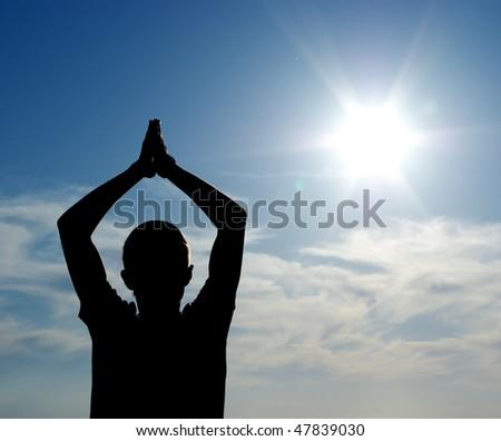 Silhouette of man and Sun. Conceptual design. - stock photo