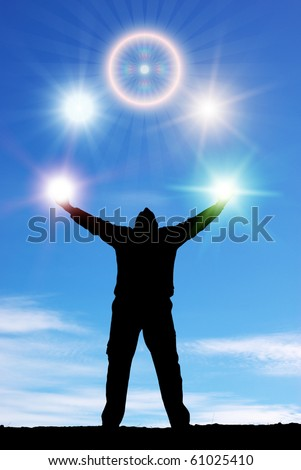 Silhouette of man and sunshine on sky background. - stock photo
