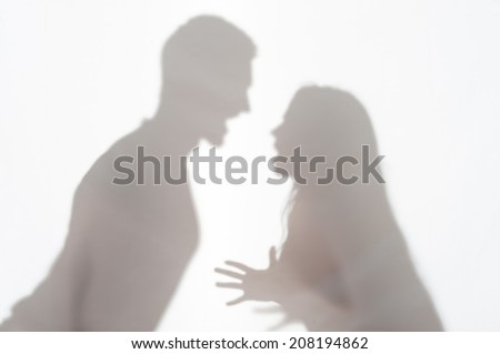 Silhouette of man and woman standing on white background and woman wanted to explain something gesticulating with her hands - stock photo