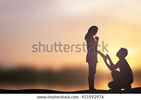 stock photo silhouette of man ask woman to marry on sea beach mountain background teen couple in love concept 415992976