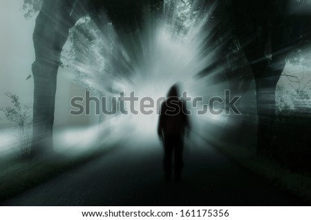 silhouette of man in dark atmosphere - stock photo