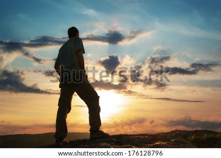 Silhouette of man in mountain. Conceptual scene. - stock photo