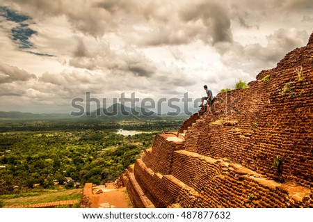 Silhouette of man in Sigiriya ruins