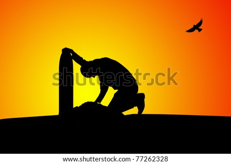 Silhouette of man near the grave at sunset - stock photo