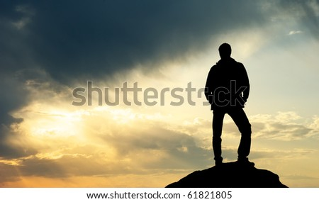 Silhouette of man on sunset. Element of design. - stock photo