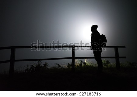 silhouette of man on the mountain at night