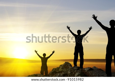 silhouette of man on the sunset.Conception of success - stock photo