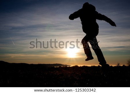 silhouette of man running in sunset