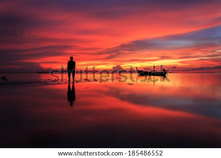 Silhouette of man stand on sunset beach in Koh Samui, Thailand - stock photo