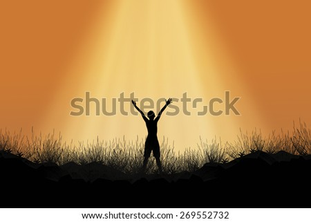 Silhouette of man standing on the mountain raise exposure.