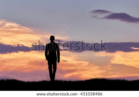 Silhouette of man walking at sunset. business concept