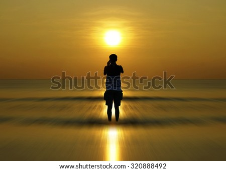 Silhouette of Man watching when sun rising up                               - stock photo