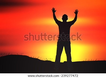 Silhouette of man with hands raised to beautiful sunset background. Merry Christmas Card, Thankful, Repentance, Reconcile, Adoration, Glorify, Peace, Evangelical, Hallelujah concept - stock photo