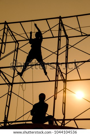 silhouette of man working for construction