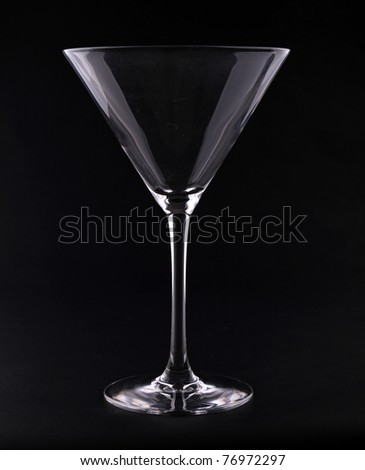 silhouette of martini glass on black background - stock photo